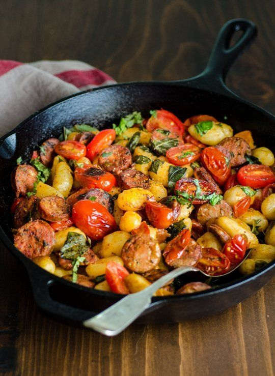 Gnocchi Skillet with Chicken Sausage & Tomatoes. Made this tonight with tortellini. Quick, super delicious, and a fantastic way to utilize fresh basil and tomatoes.