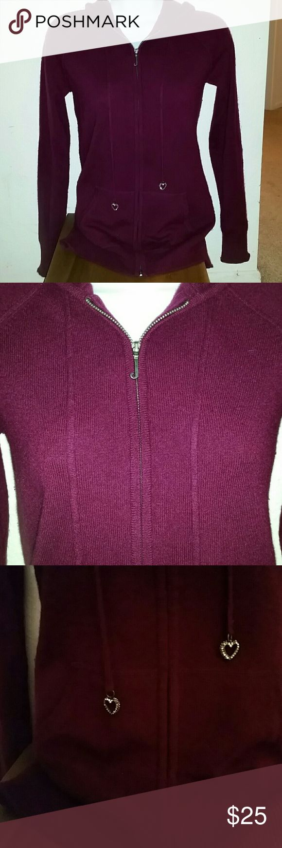 100% cashmere Juicy Couture burgundy purple zip up A great 100%; cashmere zip-up hoodie jacket by Juicy Couture in pretty purple to burgundy color. Size is petite and fits smalls. I usually can wear a small to medium and this has a little bit of stretch to it. Soft and comfy. Worn a few times but in excellent condition. A couple of stones missing off the heart charms but everything else is like new. Juicy Couture Tops Sweatshirts & Hoodies