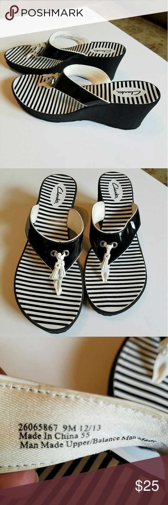Clark's black and white sandals. NWOT Ready for summer.   Black with white accent. New without tags Clarks Shoes Sandals