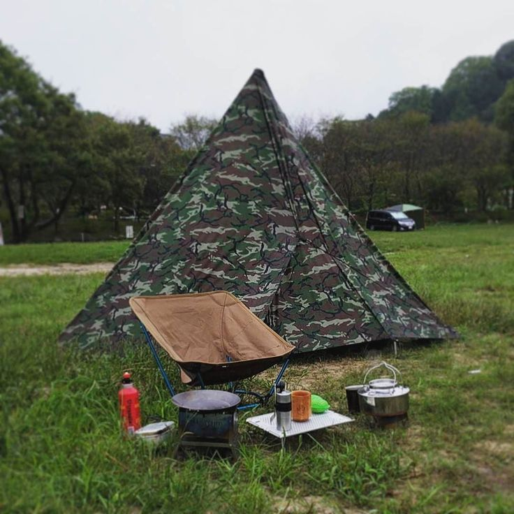Great teepee style tarp setup by @8ball_coffee using our Defender Camo tarp. #aqwaterproof #liveyourquest #camping . . . #camo #camoflauge #bushcraft #campingcollective #survival #waterproof #outdoorculture #optoutside #wildernessculture