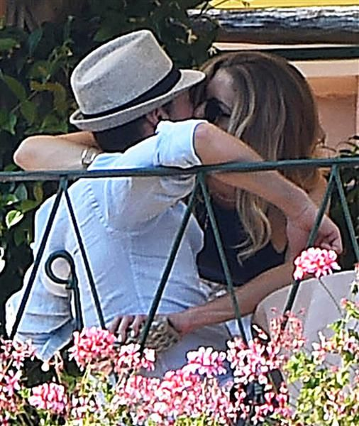 Ryan Seacrest shared a smooch with girlfriend Hilary Cruz while enjoying lunch with friends in Portofino, Italy, on July 1, 2015.