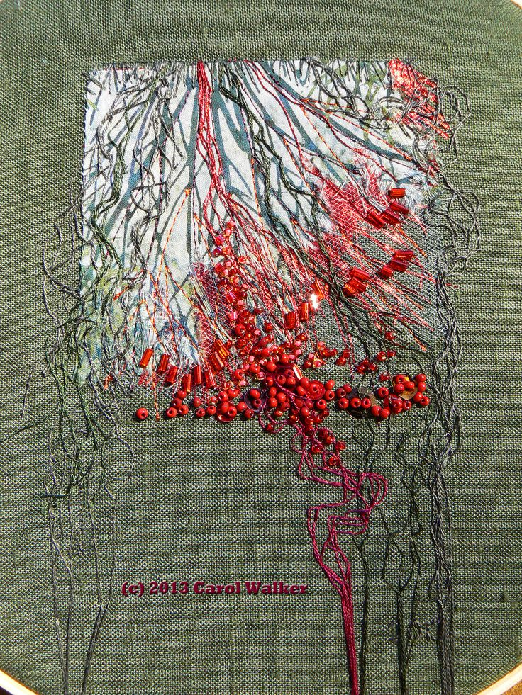 Embroidery titled 'Seep' by Carol Walker. 2013. Center detail. Printed cotton, shredded lame, netting; metallic and cotton flosses; glass beads. Base is medium weight linen. The product of a crabby mind.