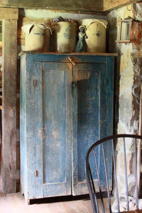 Kitchen.... great old blue cupboard with nice crocks on top........