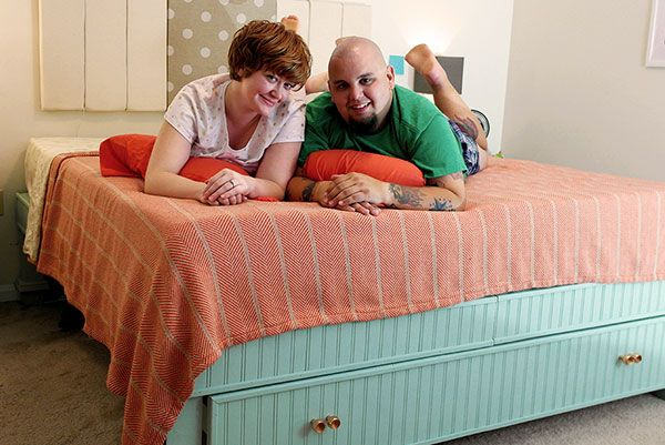 Frank Kecseti and his financee on the DIY bed frame they built
