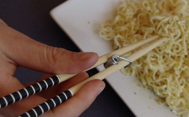 There's always that one person at the dinner party who can't seem to figure out how to use chopsticks. Tease them and alleviate their suffering by whipping out a pair of these Remedial chopsticks, easily made by combining the spring mechanism from a wooden clothespin with a regular pair of wooden chopsticks.