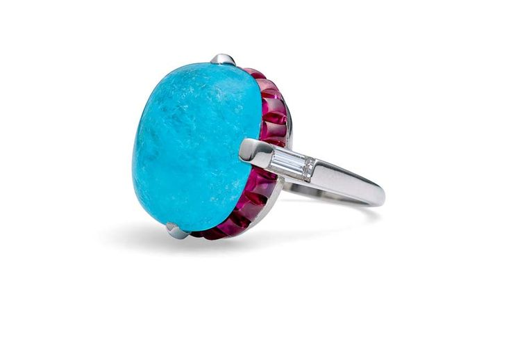 Steven Fox handmade platinum ring with a central 14.04ct Paraiba tourmaline surrounded by natural sugarloaf Burmese rubies and baguette diamonds.
