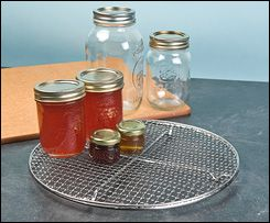 Canning and Cooling Rack - Gardening  LL: My current canning rack requires four hands to lift from the boiling water - two to lift, two to steady the smallest jars so they don't fall back in. A more solid base like this, with some kind of lifting mechanism, might fix that.
