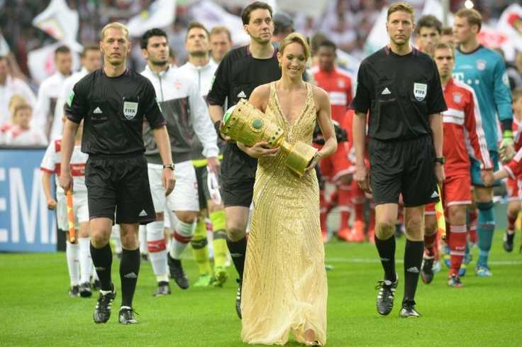 FC Bayern München - DFB-Pokalsieger 2013  #Triple --- World Kickboxing Association champion Christine Theiss carries the trophy prior to the DFB Cup Final match between FC Bayern Muenchen and VfB Stuttgart at Olympiastadion on June 1, 2013 in Berlin, Germany.