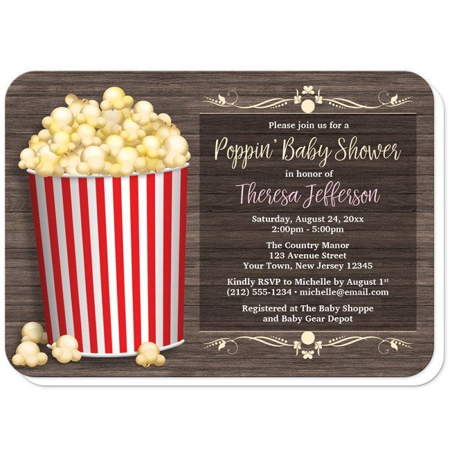 """Rustic popcorn Baby Shower invitations with a filled red-striped popcorn bucket over a brown wood pattern background and reads """"Poppin' Baby Shower""""."""