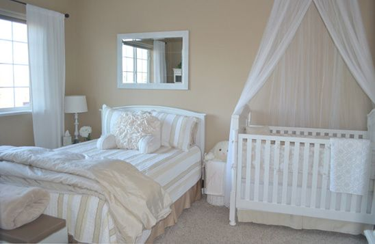 Soft, neutral nursery with bed for Mama or Daddy to use in between tending to baby.