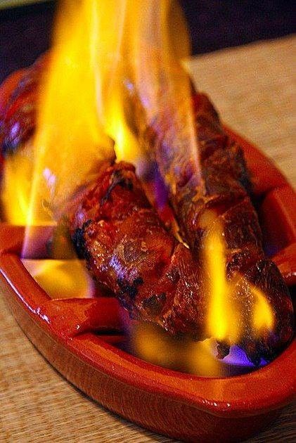 Grilled chorizo on a clay dish