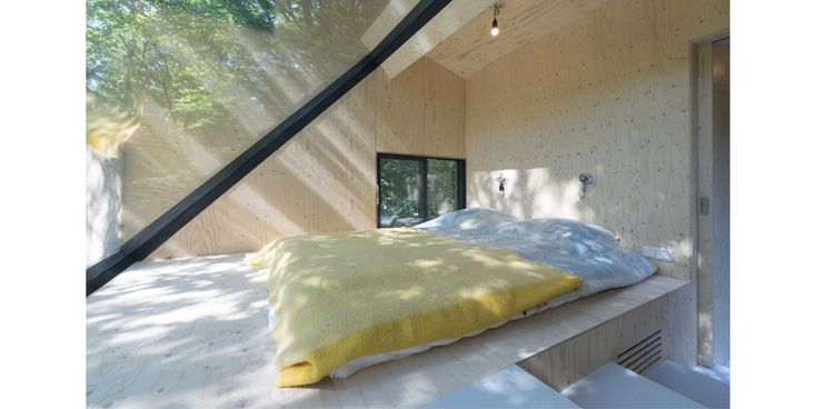 Master bedroom in cantilever extension with sunken bed and beautiful view.
