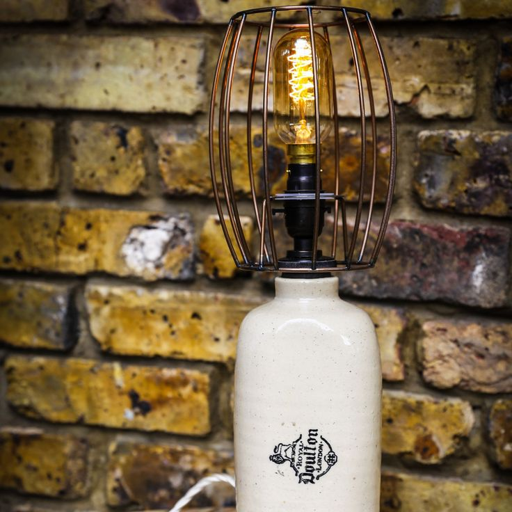 I though this was a beer jug, but it turns out that it's a 1950's hot water bottle! Now re-purposed into a lovely lamp with a copper wire bulb cage. City loft modernity or country cottage chic, this lamp will sit nicely anywhere.