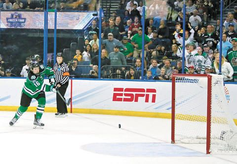 Brock Boeser fires the puck into the vacant Quinnipiac net for UND's second goal of the game. Photo by David Samson