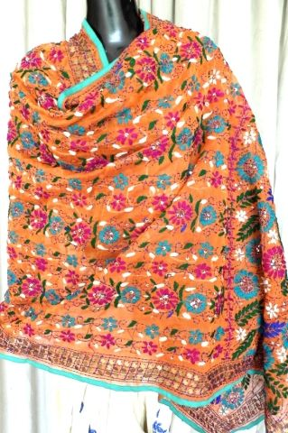 This beautiful phulkari dupatta on handloom chanderi fabric has been hand embroidered with wool thread and sequins. A graceful and stunning accessory for your evenings - See more at: http://giftpiper.com/HandembroideredChanderiPhulkariDupattaOrange-id-609278.html#sthash.QwEjmxoP.dpuf