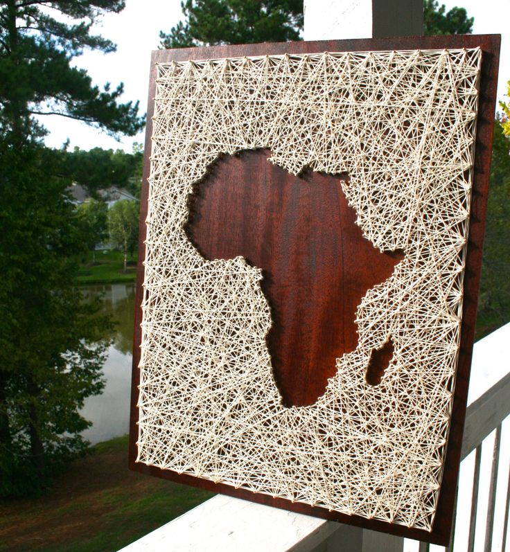 I have always had a love for the continent of Africa. The shape alone of Africa evokes many feelings. Made on dark stained wood and accented with off-white string.  This string art would be a beautiful accent piece in any room, from shabby chic to modern. Treat yourself to this conversation starter!  20x16 and comes ready to hang. The turnaround time on this piece is approximately 2-3 weeks.  This item is made to order, so your piece will be unique! The design will remain the same, but your…
