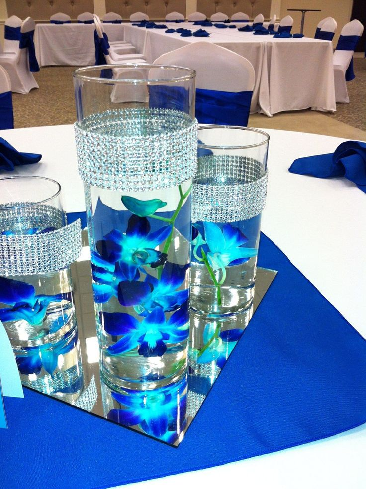 Submerged blue orchids with bling wrap trimmed vases (can top with floating candles or light with LED) $25.00 for the trio with bling wrap and floating candles.
