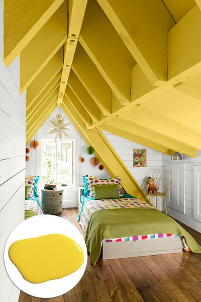 Take a right at the top of the step-ladder, and you'll find built-in twin beds tucked under the eaves of the loft with built-in cabinets for clothes and toys. Rafters are painted in Olympic's Gone Bananas. Bedding, chair and hamper by The Company Store. Photo: Deborah Whitlaw Llewellyn