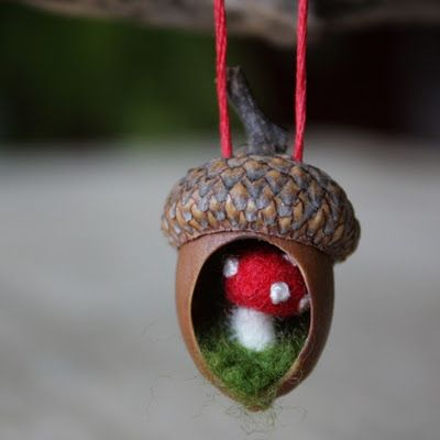 hollowed out some acorn bodies and after they were cleaned and dried, glued in a wool mushroom and moss. I sewed small french knots on the caps for their spots.