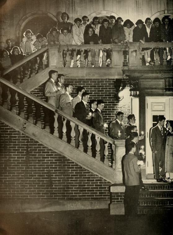 Athena yearbook, 1950. Fraternity men and sorority women serenading a couple on the stairs outside of Lindley Hall.
