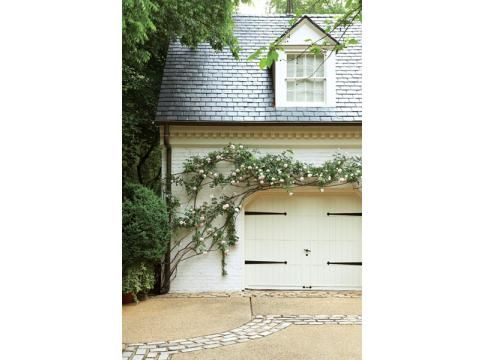 love the climbing rose over the garage and the brick inlay in the concrete driveway