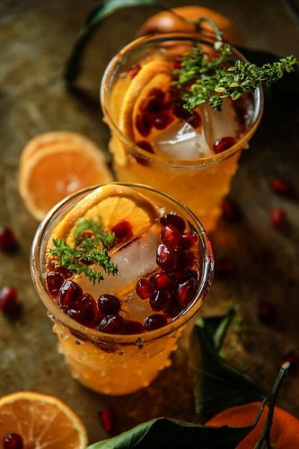 Sparkling Clementine Thyme Cocktail: 5 mins serves: 2, 4 ounces chilled vodka, 12 ounces sparkling clementine juice (I used Izzy), 2 tablespoons pomegranate seeds, 2 clementine or orange slices, two sprigs lemon thyme (garnish), ice.