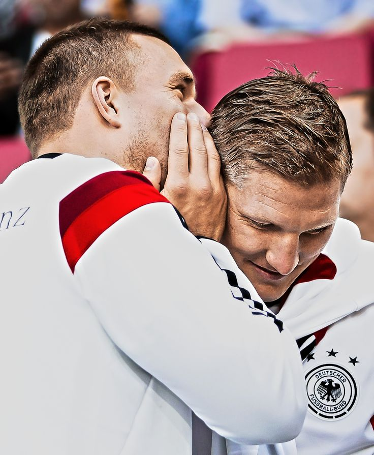 Poldi and Basti doing what they do best - whispering sweet nothings to each other.