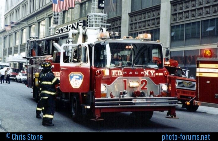 Fire Department City of New York's Ladder 12, a 1985 Mack/Baker 95' Tower unit fleet No MT8510 at a rubbish compactor fire in Midtown Manhattan Sept 4th 1996