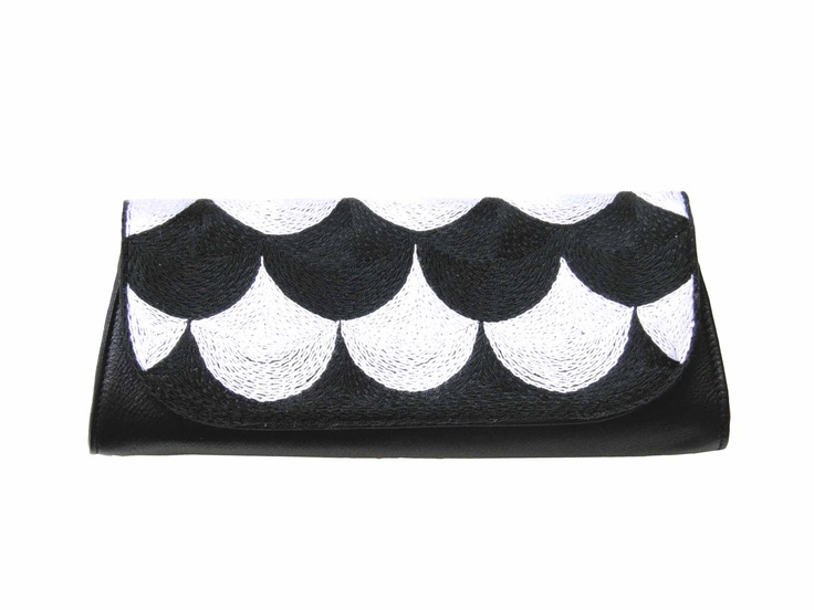 Bubbles-clutch. Pattern by Susanna Vento. Product by Mum's. Embroidered in the hands of South African women. !st quality leather.