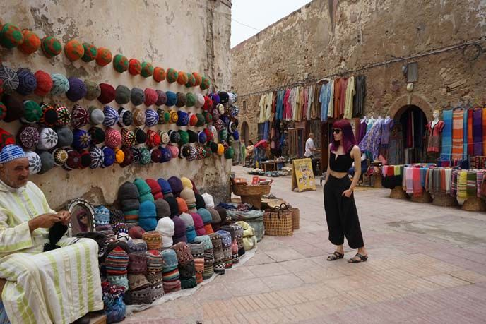 fez hat store, rainbow morocco gay lgbt, La Carmina's Morocco travel video is out! Goats on trees, argan oil, Berber cooking classes and more - see it here! http://www.lacarmina.com/blog/2016/01/berber-family-homestay-cooking-lessons-essaouira-morocco/