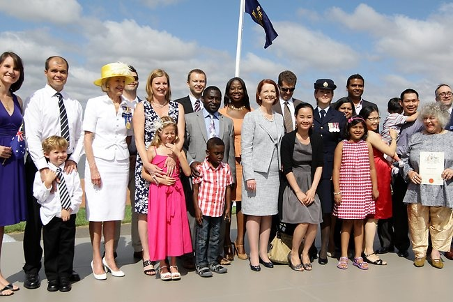PMJulia Gillard and Governor General Quentin Bryce in a group photo with all the newly-sworn Australian citizens in Canberra. Picture: Kym Smith