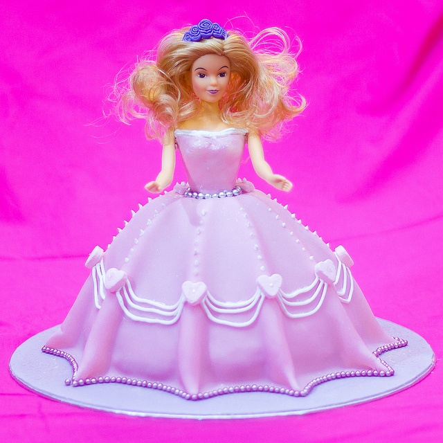 Vanilla-Buttermilk Barbie doll cake with piped royal icing and heart detail and a sparkly belt and hem trim