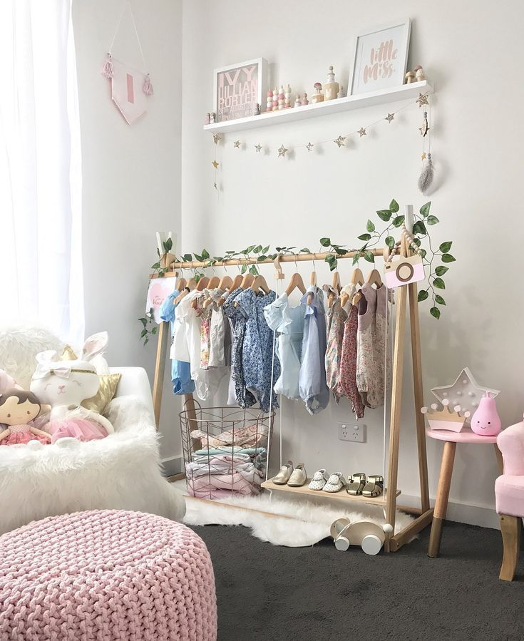 A combination of grey, white, pink and mint with a touch of gold has resulted in this beautifully light and bright nursery for baby Ivy. #Nurserydecoratingideas