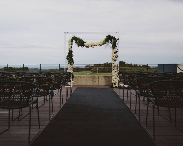 Simple but delicate floral arrangement for the ceremony