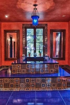 The master bath is decorated with tiles crafted in New Mexico, USA; the mirrors were made from reclaimed wood.