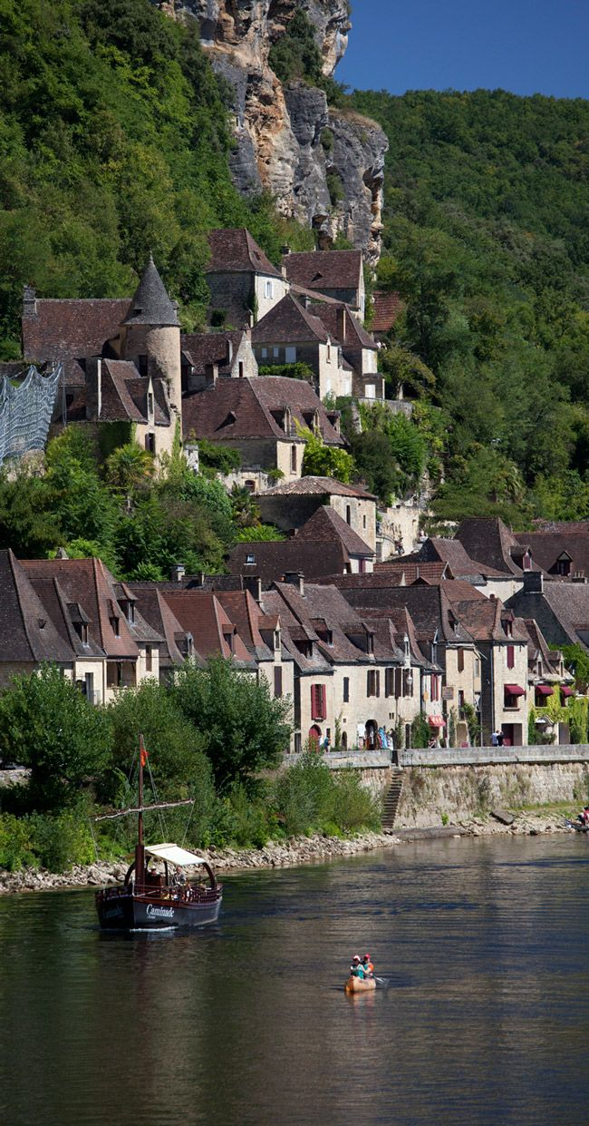 La Roque Gageac, France-We rented the house to the left of the tall cylindrical tower...amazing house on two floors...the views were so wonderful...watching people canoe each day down the river.  At night, we would slip down to the river to swim!   LOVED THIS PLACE!  Summer, 2003