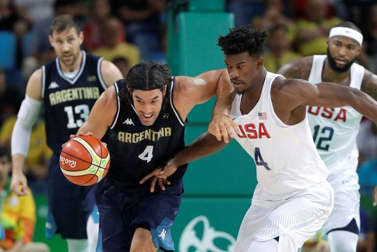 Scola drives:    Argentina's Luis Scola, left, moves the ball up court against United States' Jimmy Butler, right, during a men's quarterfinal round basketball game on Aug. 17.