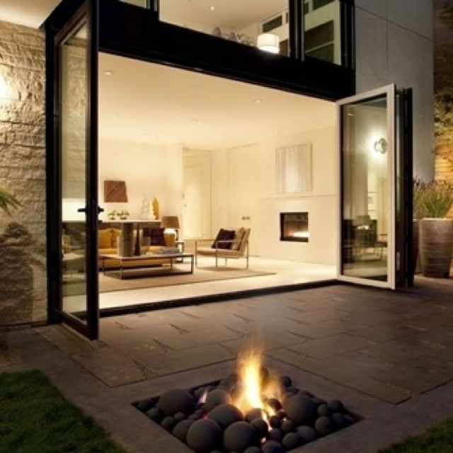 Awesome modern living area and patio. Would need a screen to keep out the mosquitoes in the summer...