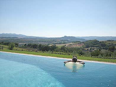 This would be a dream, lounging in the infinity pool of a Tuscan Villa overlooking beautiful Tuscan vineyards!