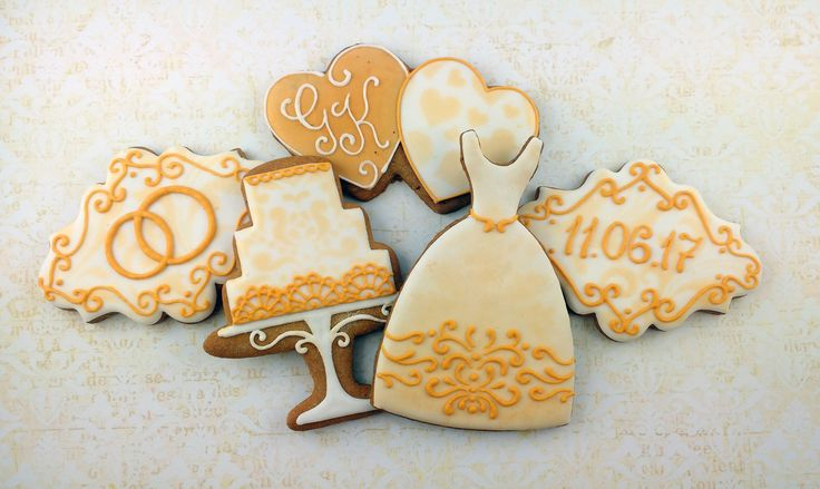 Golden and white wedding cookies: cake, wedding dress with decor, hearts with initials, label with rings and date