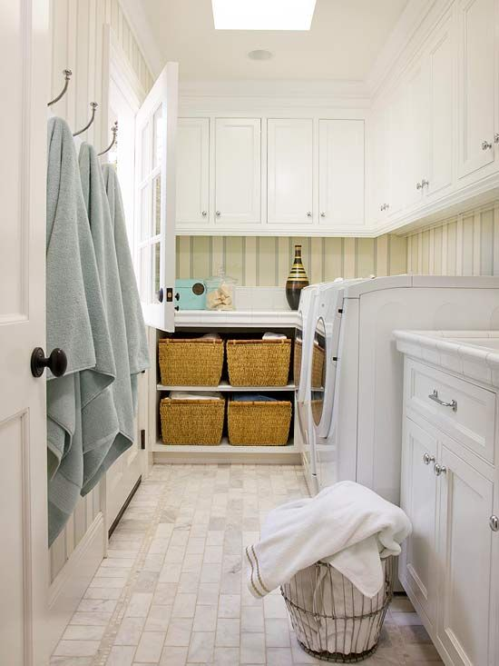 This storage-smart laundry room has hooks for drying wet towels or swimsuits along with spacious cabinets. Tour this home: http://www.bhg.com/home-improvement/remodeling/before-and-after/house-tour-renovate-restyle/?socsrc=bhgpin042113practicallaundryroom=12