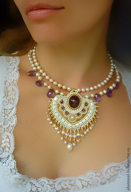 The beaded focal is stunning.  I so want to learn how to bead something like it.