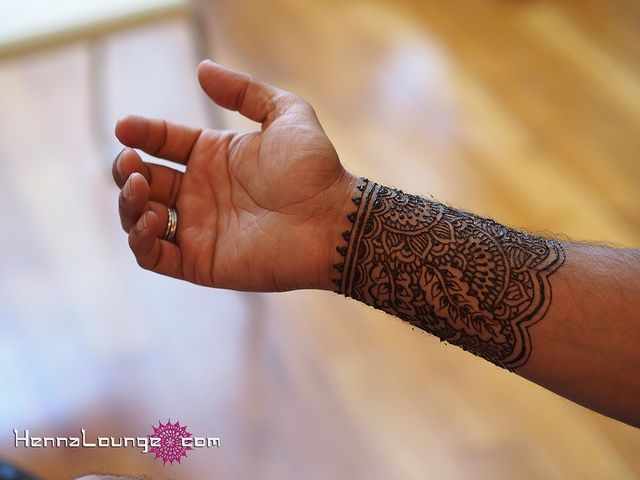 A mehndi cuff for a groom's wrist by HennaLounge, via Flickr