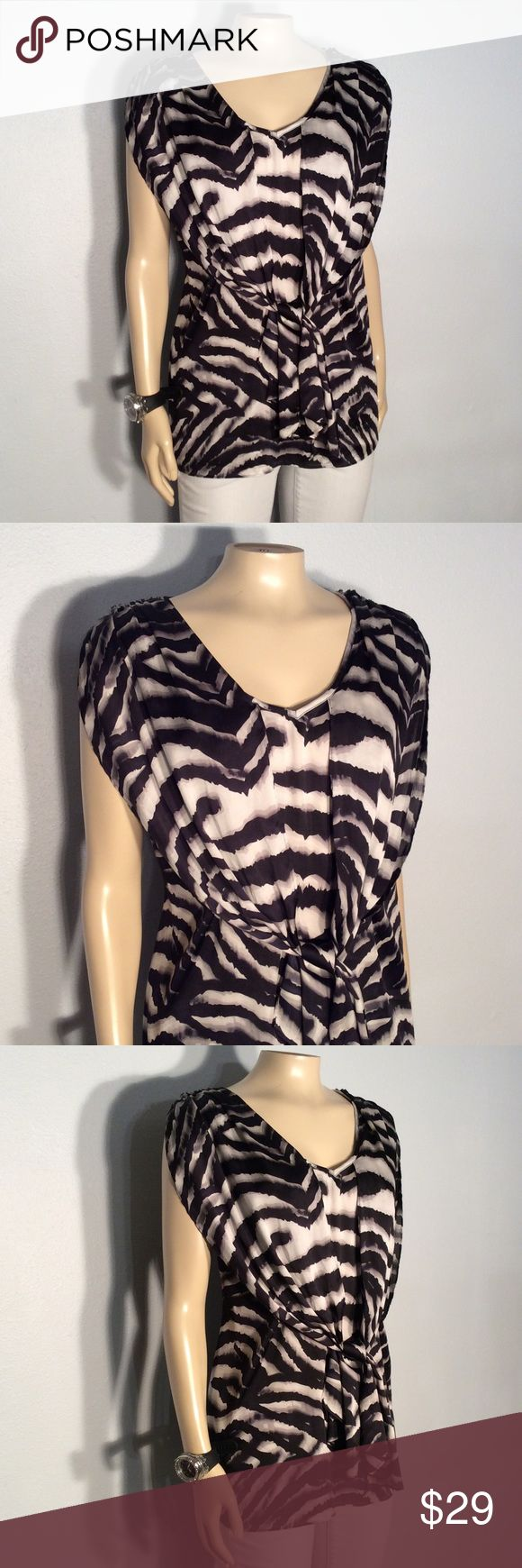 Jones New York grey & black animal print blouse Jones New York gray and black animal print blouse excellent condition no damage fabric 100% polyester Jones New York Tops Blouses