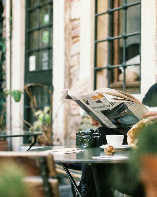 cafe | coffee | outdoors | newspapers | travel | afternoons