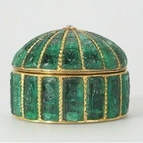 Carved emerald circular box. Mughal India circa 1635. An identical cypress is carved on each panel. Similar boxes made of various precious materials appear in Indian miniatures from the early 17th century on. They could have been for medicines (including opium, a Mughal panacea) or to hold even more precious objects, such as uncut diamonds.