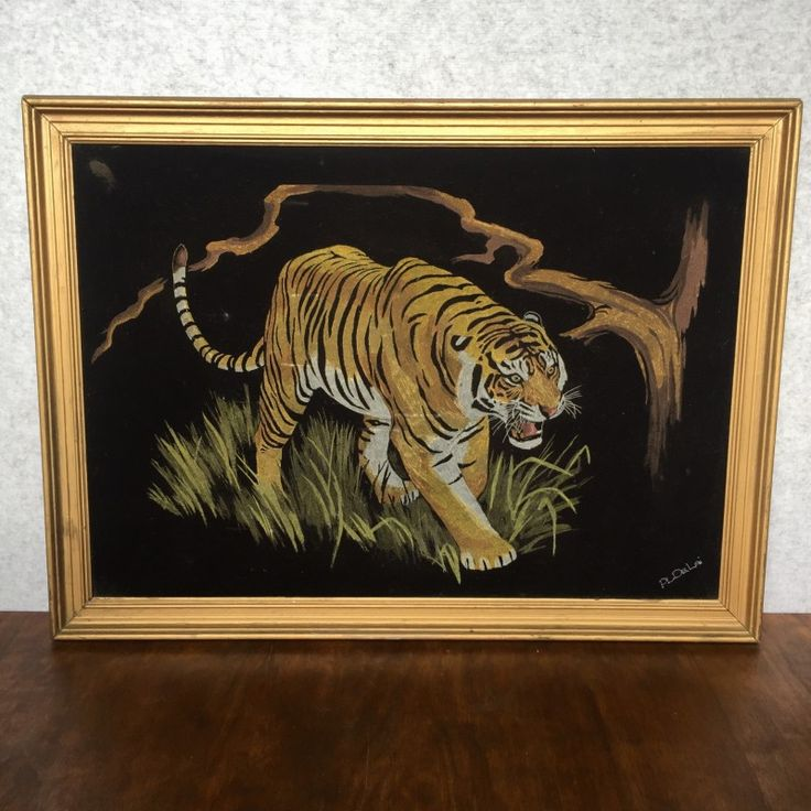 VINTAGE TIGER PAINTING ON VELVET - $85 AUD  In golden wood frame, this kitsch velvet art features prowling tiger painted by PL De Lai.  Known for the dramatic 'pop' effect of painted colour on contrasting black velvet, this medium took hold in the 50s – and much like anything considered 'kitsch', it started as an experimental medium for well renowned and respected artists of the time, before trickling down to the masses.