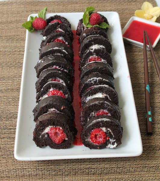 Raspberry Sushi Roll|2CookinMamas Sweet raspberries and cheesecake wrapped up in a light-as-air chocolate cake roll. Serve with raspberry sauce. @driscollsberry #raspberrydessert