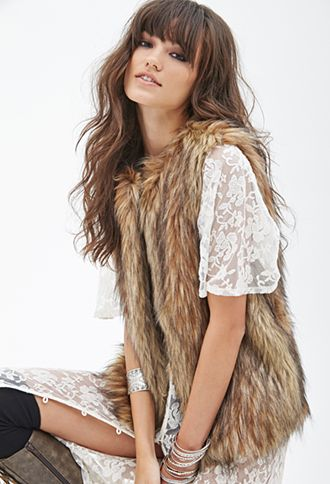 Shaggy Faux Fur Vest | FOREVER21 - 2000137658 $39.80  This is EXACTLY what I've been looking for!!! And it's out of stock. I'm on the waiting list for this beauty.