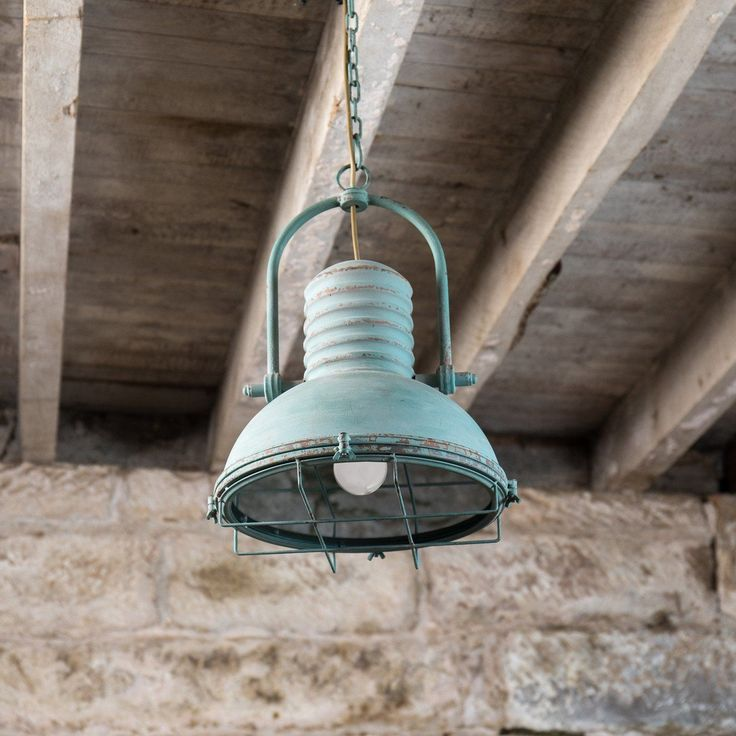 "The vintage-industrial revolution is upon us!. Check out this Hoover Pendant light, featuring the perfect blend of industrial style, vintage inspired appeal, and just the right amount of distressed turquoise color. It would look amazing hanging over your breakfast nook, kitchen island, or just about anywhere in your home. The fixture measures 14""L X 14""W X 18""H, metal and glass (light only); 14""L X 14""W X 87""H, metal and glass (light and chain)."